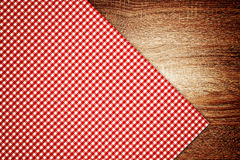 Table cloth, kitchen napkin on wooden background. Royalty Free Stock Photo