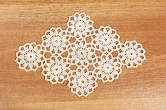 Table cloth macrame. Macrame detail Table cloth macrame on wooden table Stock Photography