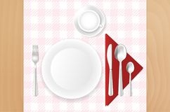 Table, cloth, plate, cup and stainless cutlery Royalty Free Stock Image