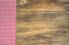 Table cloth red checkered on brown wood background. Stock Photography