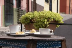 Table with coffee and bread in San Cristobal de las Casas. In San Cristobal las Casas an outdoor place to have a cup of coffee, bread or have a full breakfast stock images