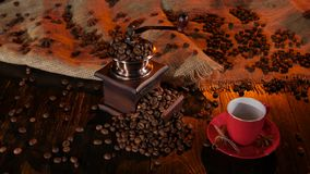 Table with a coffee grinder full of with coffee beans stock video footage