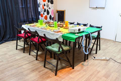 Table with cold snacks in room to celebrate a birthday or children party Royalty Free Stock Photos