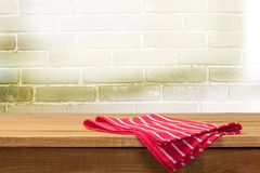 Wooden spoon and fork on napking on table. Table color red white background nobody view Royalty Free Stock Photos