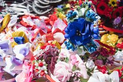 On the table are colorful decorations from flowers to the female head royalty free stock photography