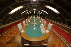 Table for conferences in the underground bunker. MOSCOW, RUSSIA - FEBRUARY 08, 2016: A long wooden table in the meeting room in the bomb shelter Royalty Free Stock Photography
