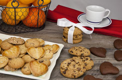 Table covered with biscuits. Decorated table for a snack with fruit, milk and cookies Stock Images
