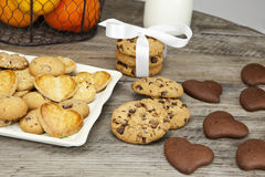 Table covered with biscuits. Decorated table for a snack with fruit, milk and cookies Royalty Free Stock Photos