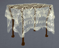 Table covered with knitted tablecloth Royalty Free Stock Photo