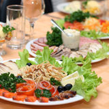 Table covered at restaurant. With fish delicacies in the foreground Stock Images