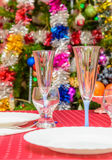 Table covered tablecloth background dressed up Christmas tree Stock Image
