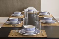 A table with crockery, plates, glasses and cutlery stock photos
