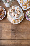 Table with cupcakes, tarts, pie and horn pastries. Copy space. Stock Image