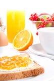 Table de petit déjeuner avec le marmelade de pain grillé et d'orange   Images stock