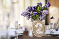 Table decor with flowers, number Stock Photos