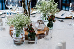 Table decor with wood centre piece Stock Photo