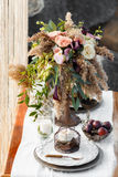 The table is decorated with a beautiful bouquet of flowers Royalty Free Stock Images