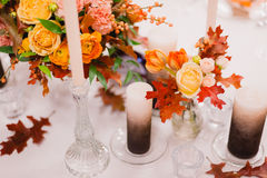 The table decorated in flowers. Beautiful flowers in vase decoration on the table,Rustic style Stock Photo