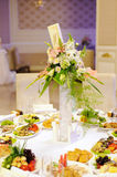 Table Decorated with Flowers Stock Images