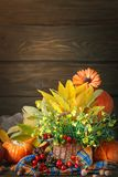 The table decorated with flowers and vegetables. Happy Thanksgiving Day. Autumn background. Royalty Free Stock Photography