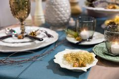 Table decorated with luxury dishes closeup, nobody Royalty Free Stock Photos