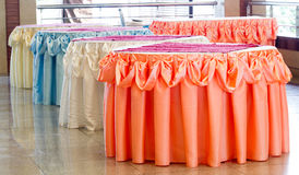 Table decorated with tablecloth restaurant page. Table decorated with orange, white, blue,and cream tablecloth restaurant page Royalty Free Stock Photo