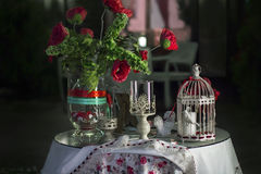 Table decorated with a vase of flowers, candlesticks and decorat Stock Photography