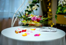 Table decorated for a wedding. With rose petals Stock Photos
