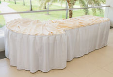 Table decorated with white table cloth. Royalty Free Stock Images
