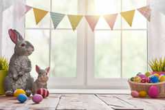 Table decorating for Easter. Happy Easter! Background with colorful eggs in basket. Table decorating for holiday Stock Photos