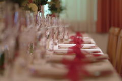 Table decoration. A ceremonial decorated dinner table with dishes and glasses Stock Photography