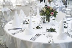 Table decoration. A ceremonial decorated dinner table in white Stock Photography