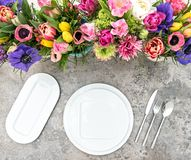 Table decoration colorful spring flowers Holidays place setting. Table decoration colorful spring flowers. Holidays place setting background royalty free stock photo