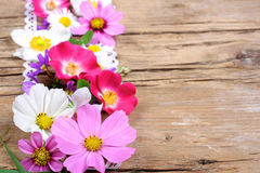 Table decoration with cosmos, roses and other flowers stock image