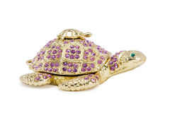 Table decoration depicting a turtle jewelry. Stock Images