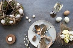 Table decoration for a easter dinner. Table decoration with champagne for a festive easter dinner Stock Images