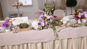 Table decoration with flowers stock video footage