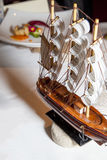 Table decoration with Galleon model Stock Images