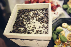Table decoration. Party table decoration with coffee beans and rice Stock Image