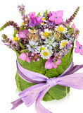 Table decoration, present, flower arrangement Stock Images