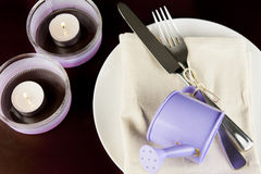 Table decoration in purple colors Stock Photography