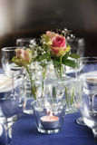 Table decoration with roses and glasses for an informal festive Royalty Free Stock Photos