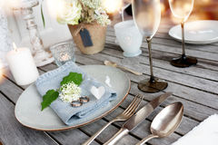 Table decoration in vintage style for a wedding dinner Royalty Free Stock Image