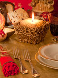 Table with decorations for Christmas dinner Royalty Free Stock Images