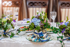 Table decorations with flowers Stock Images