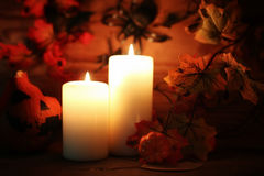 Table decorations for Halloween carved pumpkin head candles Royalty Free Stock Images