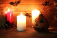 Table decorations for Halloween carved pumpkin head candles Royalty Free Stock Photography