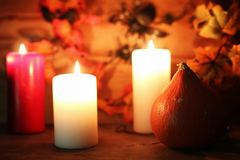Table decorations for Halloween carved pumpkin head candles Royalty Free Stock Photo