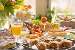 Table with delicatessen ready for Easter brunch. Breakfast or brunch table filled with all sorts of delicious delicatessen ready for an Easter meal Royalty Free Stock Photos