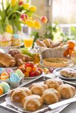 Table with delicatessen ready for Easter brunch stock image